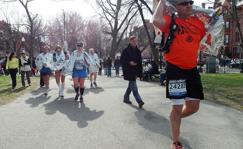 April 15, 2013 - Runners who were not allowed to complete the full 26.2-mile course make their way back toward the finish line after two explosions brought the 117th Boston Marathon to a halt. Photo by Sarah Ganzhorn / BU News Service