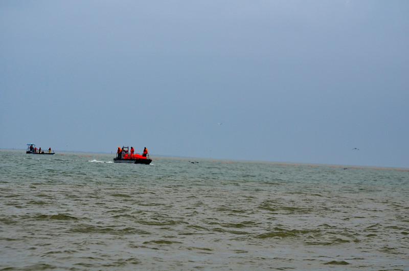 Coast Guard coordinates boom placement. <em> Photo credit: Peggy Wilkinson</em>