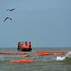 As the oil spill in Galveston Bay expands, the U. S. Coast Guard places booms to guard the shores and bird habitats in Matagorda Bay. <em> Photo credit: Peggy Wilkinson</em>