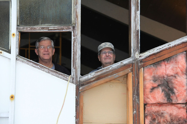 Dale Landis of Pendleton and Ron Wheeler of Middletown look out of the removed stained glass window frame as South Meridian Church of God continues its renovation.<br /> <br /> Photographer's Name: Jerry Byard<br /> Photographer's City and State: Anderson, Ind.