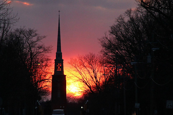 On the 'first' cold day of Spring the sun was setting due West and silhouetted Park Place Church in Anderson.<br /> <br /> Photographer's Name: Jerry Byard<br /> Photographer's City and State: Anderson, IN