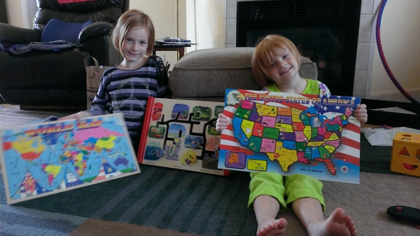 Sisters Natalie and Kendall Long aren't puzzled at all by world and U.S. geography. Submitted by grandmother, Susan Cox.<br /> <br /> Photographer's Name: Susan Cox<br /> Photographer's City and State: Alexandria, Ind.