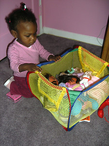 Lauryn playing with her toys.