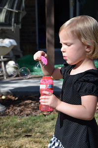 Devyn blowing bubbles