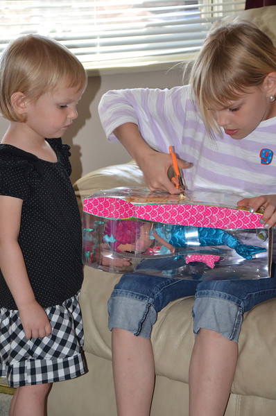 Devyn really wanted this toy, and McKenna worked on it for awhile, it was seriously packaged