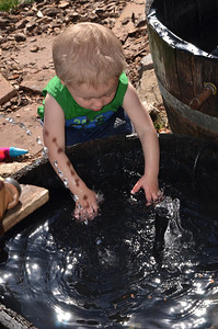 Aiden playing in the fountain