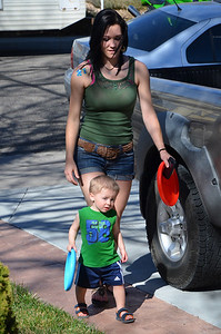 Kelli and Aiden walking home from the park, I love the look he has here