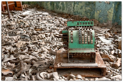 Cash register and gas masks in a school inside the 30 kilometer Chernobyl exclusion zone, Pripyat, Ukraine.