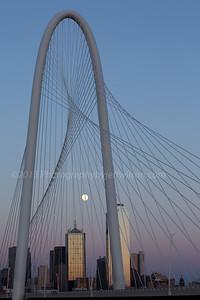 Moon rising through the Margaret Hunt Hill Bridge, Dallas, Texas