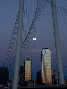Full moon through Margaret Hunt Hill Bridge, Dallas, Texas.