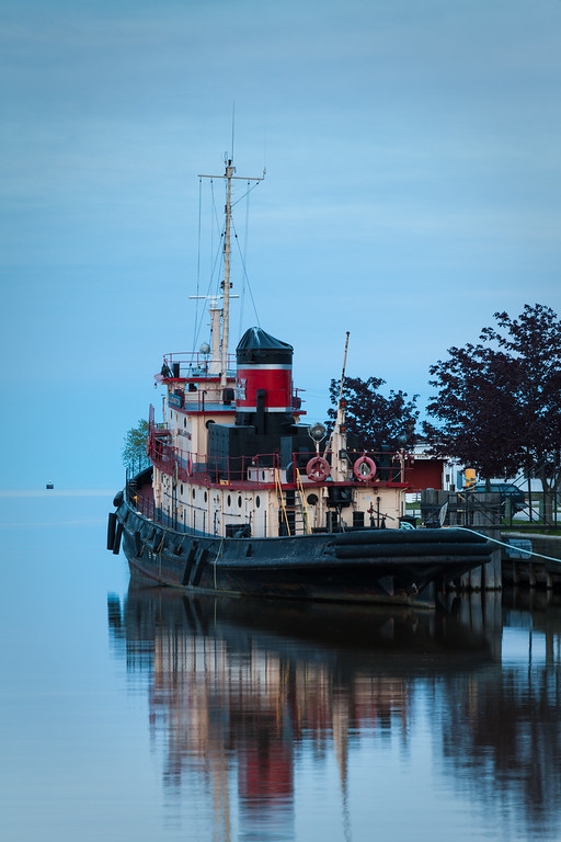 Tugboat Ludington has been part of Kewaunee since 1947. Although it rest peacefully in the harbor, it had a much more aggresive history. This tugboad was built in 1943 to server in WWII and participated in the D-Day invasion of Normandy, towing ammunition barges across the English Channel. Kewaunee, WI<br /> <br /> WI-100515-0290