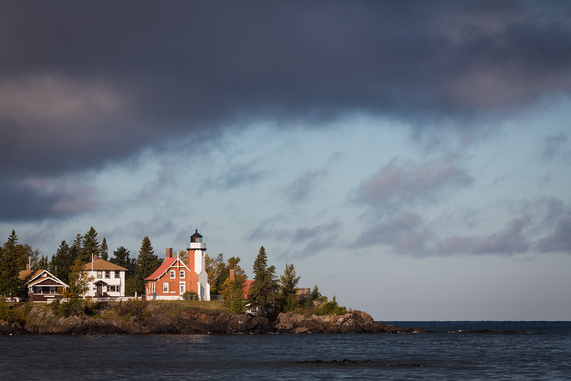Clouds move over the Eagle Harbor lighthouse during a crisp fall morning. Eagle Harbor, MI<br /> <br /> MI-120929-0061