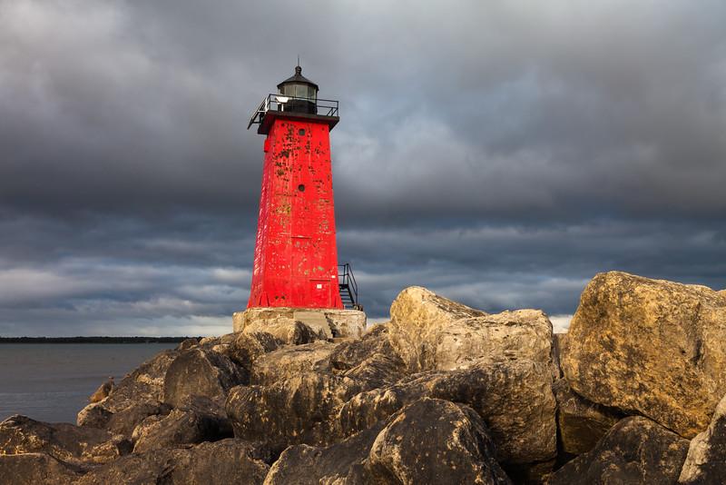 Sunshines illuminates the Manistique East Breakwater Light on a stormy morning. Manistique, MI<br /> <br /> MI-110930-0112
