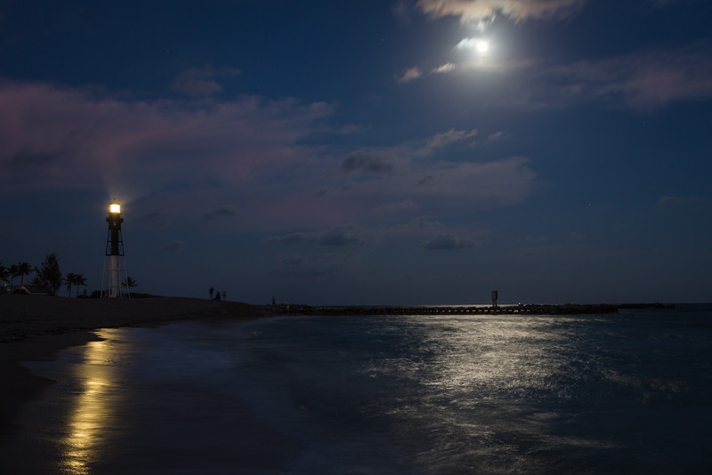 The beach near the Hillsboro Inlet channel glows with the light of moon and the lighthouse. Pompano Beach, FL<br /> <br /> FL-121226-0049