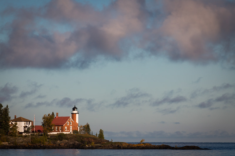 Clouds move over the Eagle Harbor lighthouse during a crisp fall morning. Eagle Harbor, MI<br /> <br /> MI-120929-0040