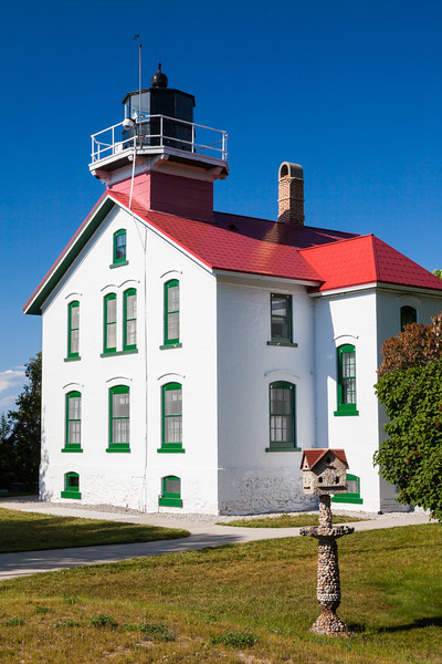 Grand Traverse Lighthouse glows in late afternoon light. Northport, MI<br /> <br /> MI-090625-0051