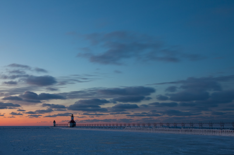 The sky behind the St. Joseph Lights glow orange as sunset fades away. St. Joseph, MI<br /> <br /> MI-090125-0207