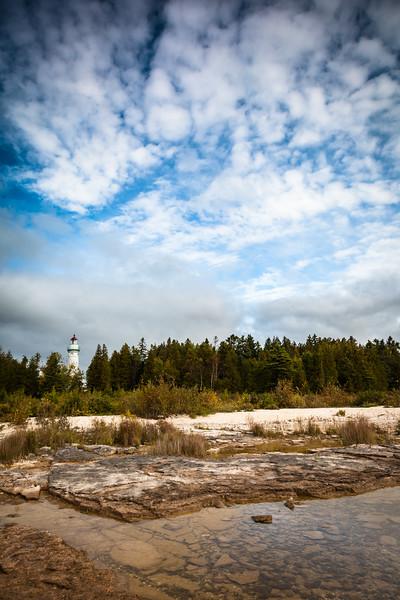 Rocky Lake Michigan shore by the Seul Choix Lighthouse. Gulliver, MI<br /> <br /> MI-110930-0178