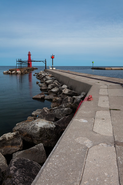 The Algoma Light watches over the peaceful Lake Michigan waters. Algoma, WI<br /> <br /> WI-100515-0270