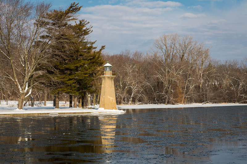 The Fabyan Lighthouse reflects on the icy waters of the Fox River. Geneva, IL<br /> <br /> IL-130205-0009