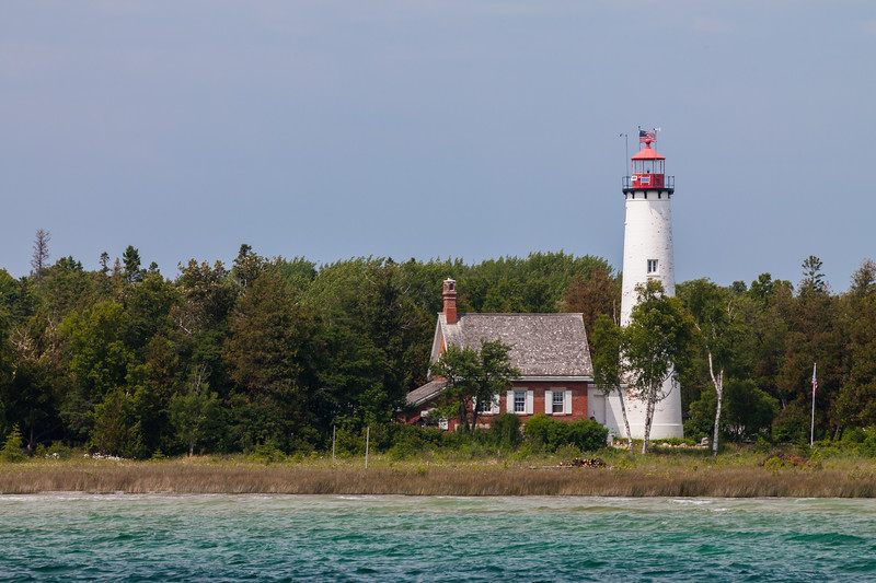 The St. Helena Island Lighthouse is located approximately 10 miles west of the Mackinac Bridge. The light started operating in 1873 and was the first in Michgan to lose its keeper (automated in 1922). The Coast Guard recommended razing the lighthouse complex in the early 1980s but only the assistant keeper's house and boathouse were destroyed. The lighthouse is now under the care of the Great Lakes Lighthouse Keepers Association which is restoring the facility to its former glory. Straits of Mackinac, MI<br /> <br /> MI-110707-0391