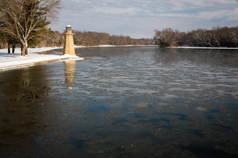 Ice floats past the Fabyan Lighthouse on a cold winter morning. Geneva, IL<br /> <br /> IL-130205-0026