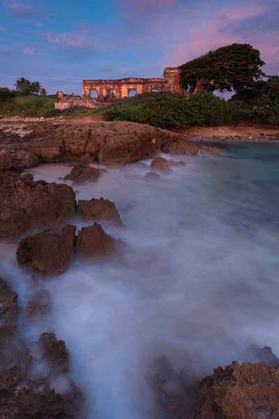 A passing storm leaves behind a spectacular sunset over the ruins of the old Aguadilla's Lighthouse. Aguadilla, PR<br /> <br /> PR-110727-0066