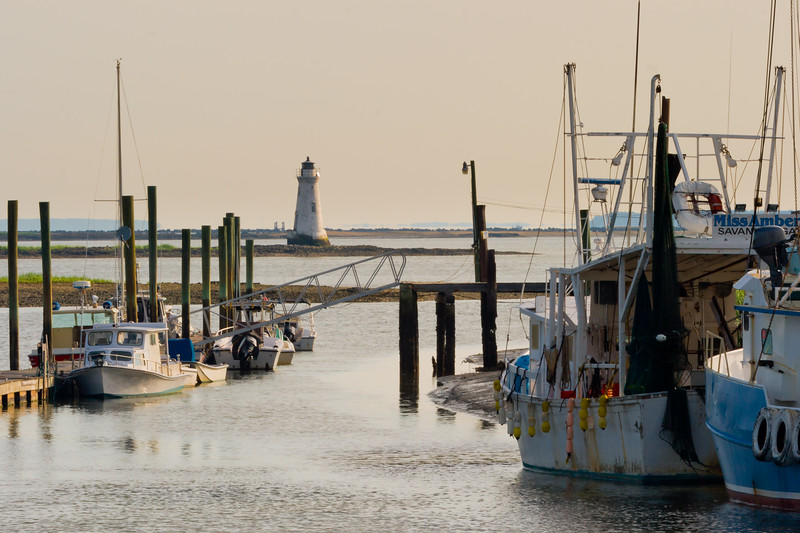 Fishing boats line up the shores of the Savannah River near Cockspur Island in the early morning. Tybee Island, GA<br /> <br /> GA-080626-0054