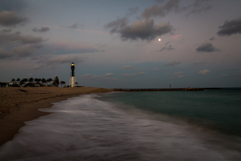 The light of the Hillsboro Inlet lighthouse shines at dusk on a warm late December evening. Pompano Beach, FL<br /> <br /> FL-121226-0020