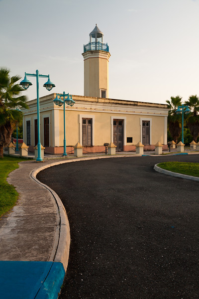 The Punta Figuras Lighthouse was completed in 1893 and remained in operation until 1938. During WWII the building was used as a lookout. In 2002/2003, affter many years of neglect and vandalism, the building was restored.  Arroyo, PR<br /> <br /> PR-110801-0088