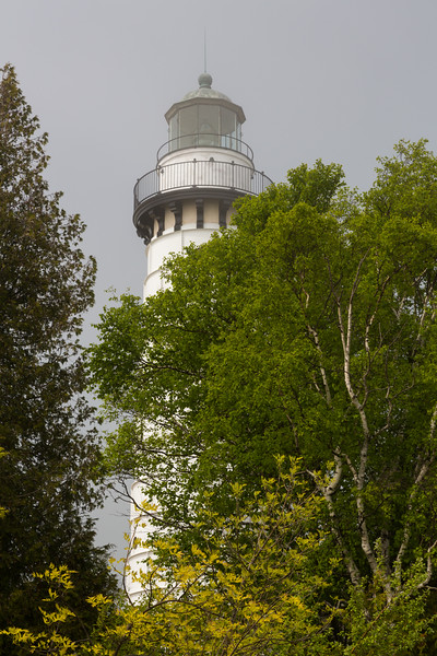 Rising above the treeline, the Cana Island Lighthouse still lights the way across Door County. Baileys Harbor, WI<br /> <br /> WI-150614-0043