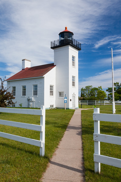 The Sand Point Lighthouse warned the ships approaching escanaba from 1868 to 1939. Throughout its history, the lighthouse underwent several modification. After extensive rennovations, the building was restored to its original appearance. Escanaba, MI<br /> <br /> MI-090621-0047-1