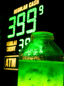 A jar of algae is juxtaposed with a BP gasoline sign in downtown Ann Arbor, MI on March 19, 2012.  Alternative energy versus oil has become a major campaign issue as the presidential election draws near.