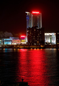 Lights from Ceasars Casino in Windsor, Canada reflect off the Detroit river before the sun comes up on the first press day of the North American International Auto Show in Detroit, Michigan on Jan, 9 2012.