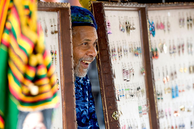 Khalil Naim of Southfield smiles while selling handcrafted jewelry inside his booth during the 17th annual African American Festival in downtown Ann Arbor, MI on June 2, 2012.