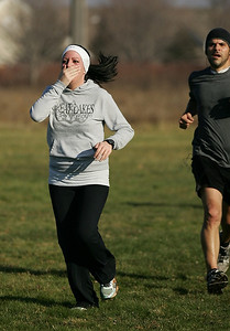 Katie Knight of North Ridgeville reacts as she approaches the finish line. photo by Ray Riedel