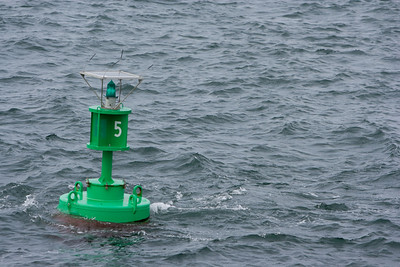 Green buoy leaving the harbor.