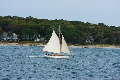 """Gaff rigged sailboat """"Liberty"""" near the shore of Martha's Vineyard."""