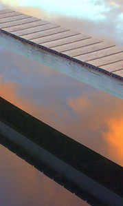 Dock Reflection at Sunrise