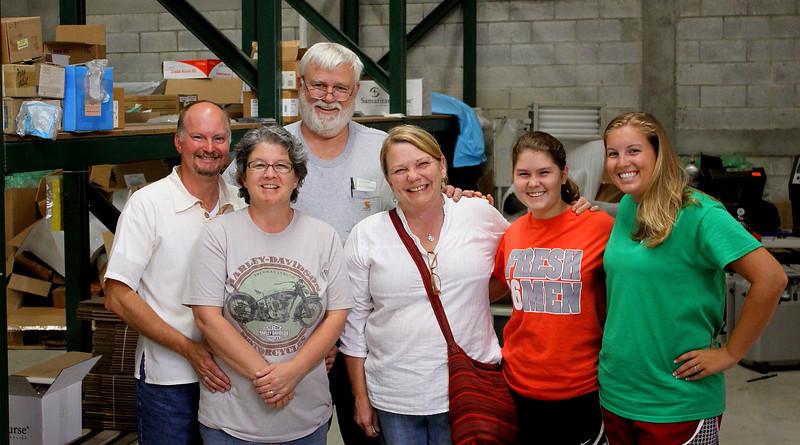 Marty, Joy, Dennis, Cindy, Sarah and Hannah in the bodega for Vine International.