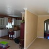 Living room looking towards kitchen & foyer