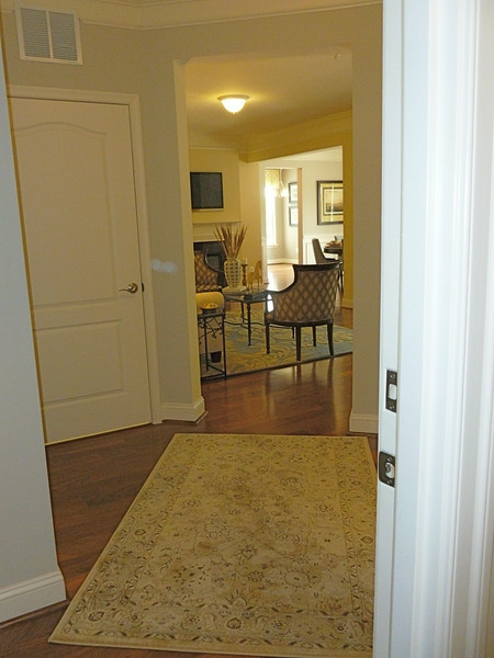 Entry is made of 4 doors:  Laundry and closet on left, full bath and guest bedroom on right.