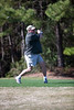 Bill Comer tees off on the Heathland course at the Legends complex during the 2011 Maseratti