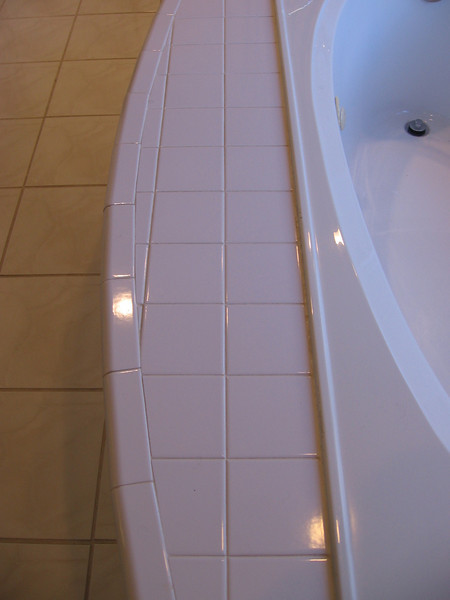 Before: When we chose a granite slab for the lav counters we learned there was enough left over to do the jacuzzi surround, so the project began to expand.