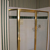Before: We love the shower-for-two. It's more fun than a Hops House open mike, and we don't even have to think about what to wear, but the tile is the wrong color and that gold-metal-frame surround has a cheap spec home look. So this will require a complete demolition and rebuild. There goes out sons' inheritance.