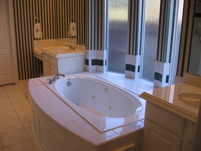 Before: A wider shot of the jacuzzi. Willie suggests while he's demolishing everything else we might as well replace all the fixtures with higher quality ones.