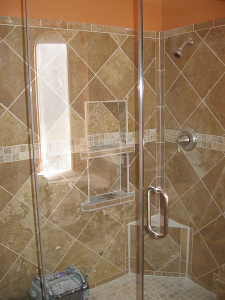 The shower enclosure was installed today.