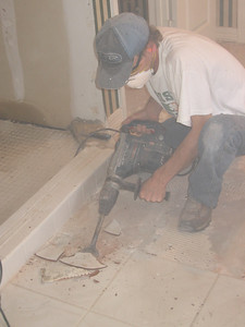 Tony stirs up a sahara-intensity dust storm with his electric tile remover.