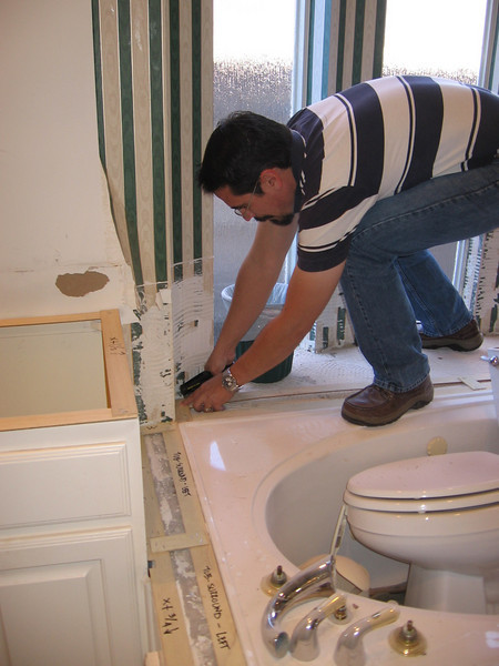 Roberto building a template for the granite jacuzzi surround.