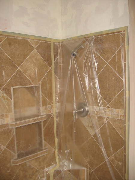 The shower masked in prep for spraying the wall above.